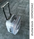 Small photo of Black and gray colored small size, travel luggage (cabin sized suitcase) in the air port.