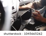 person's hand cleaning air... | Shutterstock . vector #1045665262