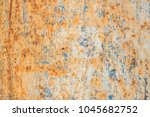 old blue painted wall with rust ... | Shutterstock . vector #1045682752