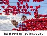 unidentified woman hangs... | Shutterstock . vector #1045698856