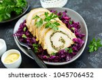fried pork loin stuffed with... | Shutterstock . vector #1045706452