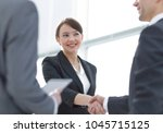 businesswoman shaking hands... | Shutterstock . vector #1045715125