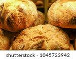 freshly baked bread in a shop... | Shutterstock . vector #1045723942