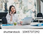 intern at the office working on ... | Shutterstock . vector #1045737292