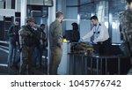 airport security apprehending a ... | Shutterstock . vector #1045776742