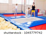 family in trampoline center | Shutterstock . vector #1045779742