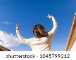 beautiful young woman making... | Shutterstock . vector #1045799212