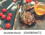 appetizing grill steaks with... | Shutterstock . vector #1045804672