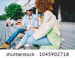 Stock photo trendily dressed hipster friends spending coffee break together walking akita inu dog on city 1045902718