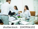 handshake manager and the... | Shutterstock . vector #1045906102