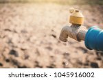faucet on cracked dry ground  ... | Shutterstock . vector #1045916002