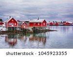 Beautiful winter landscape with traditional Norwegian fishing huts in Lofoten islands in Norwegian Sea, Norway - stock photo