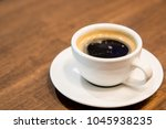 cup of coffee on table   Shutterstock . vector #1045938235