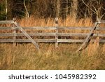 Four Rail Wooden Fence With Th...
