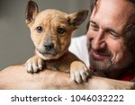 the adult handsome man holds on ... | Shutterstock . vector #1046032222