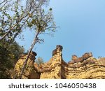 Small photo of High cliff with sky as background.Little cranyon occurred from water corrosion. Places of interest in Northern Thailand.(Pha chor , Chiang Mai , Thailand)