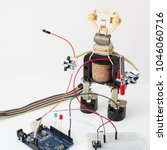 a metal robot and an electronic ... | Shutterstock . vector #1046060716