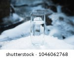 a transparent glass glass with... | Shutterstock . vector #1046062768