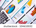 financial paper charts and... | Shutterstock . vector #104610032