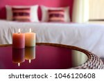 two aromatic candles on a glass ... | Shutterstock . vector #1046120608