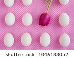 White Eggs And Pink Flower On...