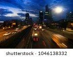 night falls on city  evening... | Shutterstock . vector #1046138332