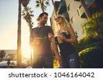 trendy attractive couple... | Shutterstock . vector #1046164042
