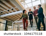 group of coworkers standing at... | Shutterstock . vector #1046175118