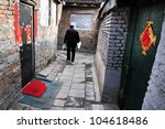 Chinese Man Walks Home In A...