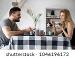 loving couple sitting at a... | Shutterstock . vector #1046196172