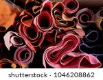 multicoloured leather in rolls... | Shutterstock . vector #1046208862