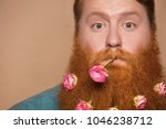 a bearded man with a decorated... | Shutterstock . vector #1046238712