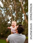 a father laughs and interacts...   Shutterstock . vector #1046240626