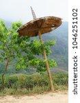 sunshade or big umbrella  | Shutterstock . vector #1046251102