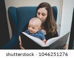 mother reading a book to her...   Shutterstock . vector #1046251276