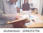 good teamwork  workplace... | Shutterstock . vector #1046251756