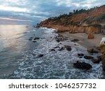 scenic ocean beach with rocks... | Shutterstock . vector #1046257732