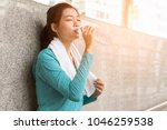 asian woman drinking water to... | Shutterstock . vector #1046259538
