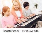 lovely elderly woman teaches... | Shutterstock . vector #1046269438