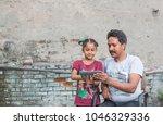 an unidentified person helps an ...   Shutterstock . vector #1046329336