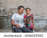 an unidentified person helps an ...   Shutterstock . vector #1046329342
