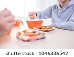 girl eating delivery food with... | Shutterstock . vector #1046336542