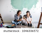 asian family renovating the... | Shutterstock . vector #1046336572