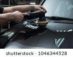 car detailing   man holds a... | Shutterstock . vector #1046344528