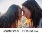 cropped image of mother and...   Shutterstock . vector #1046356762