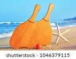 sea coast in the tourist season.... | Shutterstock . vector #1046379115
