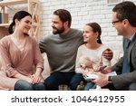 happy family of three talking... | Shutterstock . vector #1046412955