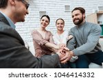 adult man shakes hands with... | Shutterstock . vector #1046414332