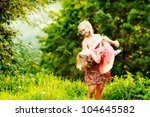 mom keeps daughter in her arms...   Shutterstock . vector #104645582