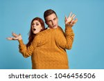 surprised young couple in one...   Shutterstock . vector #1046456506